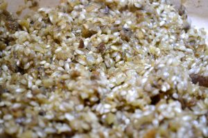 Adding Aborio rice to mushroom mixture for Italian Mushroom and Pea Risotto