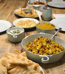 Indian meal with Hali Aloo, Curry Roasted Cauliflower, homemade hummus, Raita, dahl and warm Naan bread
