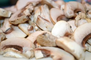 White mushrooms chopped for Italian Mushroom and Pea Risotto